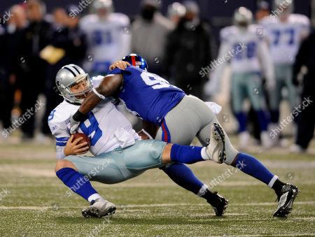 Clint Sintim, Tony Romo. New York Giants linebacker Clint Sintim (97) sacks Dallas Cowboys quarterback Tony Romo (9) in the second quarter of their NFL football game at Giants Stadium in East Rutherford, N.J