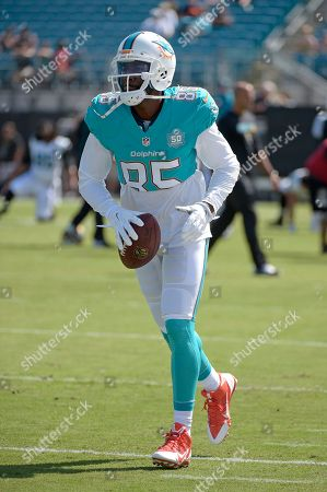 Miami Dolphins wide receiver Greg Jennings (85) warms up before an NFL football game against the Jacksonville Jaguars in Jacksonville, Fla