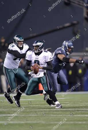 Red Bryant, Todd Herremans, Vince Young. Philadelphia Eagles offensive tackle Todd Herremans, left, quarterback Vince Young, second from left, and Seattle Seahawks defensive end Red Bryant in the first half of an NFL football game, in Seattle