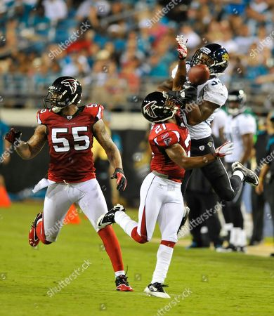 Atlanta Falcons cornerback Chris Owens (21) breaks up a pass intended for Jacksonville Jaguars running back Richard Murphy (34) as Atlanta Falcons' John Abraham runs interference during the first half of an NFL preseason football game, in Jacksonville, Fla