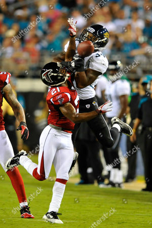 Richard Murphy, Chris Owens. Jacksonville Jaguars running back Richard Murphy (34) and Atlanta Falcons cornerback Chris Owens (21) fight for a ball during the first half of an NFL preseason football game in Jacksonville, Fla