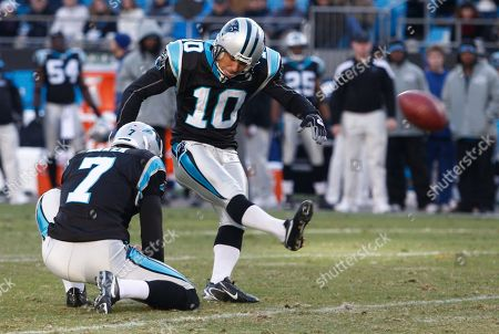 Olindo Mare, Jason Baker. Carolina Panthers' Olindo Mare (10) kicks a field goal against the Atlanta Falcons as Jason Baker (7) holds during the fourth quarter of Falcons' 31-23 win in an NFL football game in Charlotte, N.C., . Mare missed the field goal