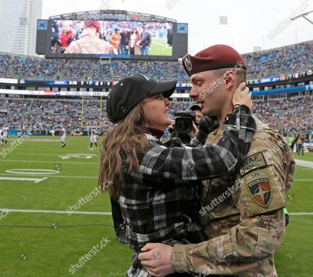 Eric Roth, Danielle Roth. Spc. Eric Roth, right, hugs his wife, Danielle, left, after surprising her with his homecoming during a timeout in the first half of an NFL football game between the Carolina Panthers and the Atlanta Falcons in Charlotte, N.C