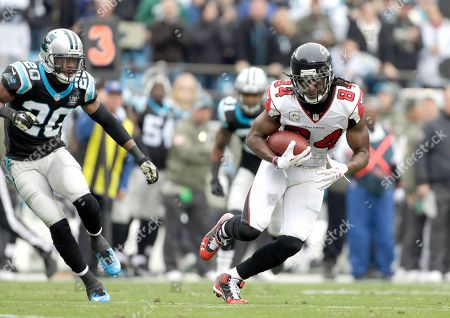 Roddy White, Antoine Cason. Atlanta Falcons' Roddy White (84) gets a pass and runs away from Carolina Panthers' Antoine Cason (20) during the first half of an NFL football game in Charlotte, N.C., . The Falcons won 19-17