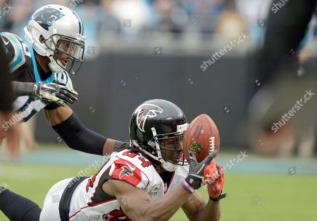 Roddy White, Antoine Cason. Atlanta Falcons' Roddy White (84) tries to pull in a pass against the Carolina Panthers' Antoine Cason (20) during the second half of an NFL football game in Charlotte, N.C., . The Falcons won 19-17