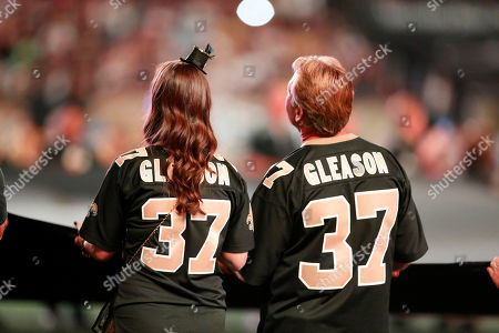 New Orleans Saints fans wear jerseys in honor of former player Steve Gleason, in the first half of an NFL football game against the Atlanta Falcons in New Orleans