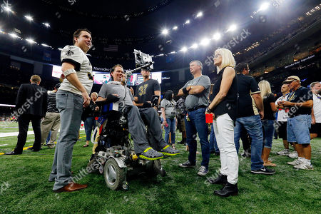 Former New Orleans Saints Steve Gleason mingles on the sideline before an NFL football game against the Atlanta Falcons in New Orleans