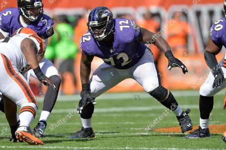 Baltimore Ravens guard Kelechi Osemele (72) blocks during an NFL football game against the Cleveland Brown, in Cleveland. While the draft often comes down to who is the highest-rated player overall when a team's turn comes _ even when the draftee doesn't necessarily fit a huge need _ the spending spree that begins, is a much different marketplace