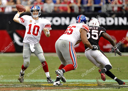 Eli Manning, Will Beatty, Joey Porter. New York Giants quarterback Eli Manning (10) throws under pressure from Arizona Cardinals outside linebacker Joey Porter (55) as Will Beatty (65) defends during the second half of an NFL football game, in Glendale, Ariz. The Giants won 31-27