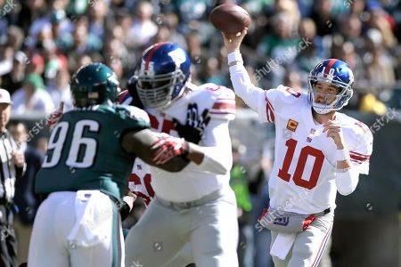 Eli Manning Will Beatty, Bennie Logan. New York Giants quarterback Eli Manning (10) throws a pass as Will Beatty (65) blocks Philadelphia Eagles' Bennie Logan (96) during the first half of an NFL football game in Philadelphia