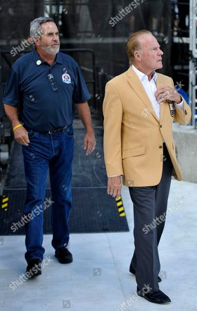 Frank Gifford, Dan Fouts. Former NFL football players Frank Gifford, right, and Dan Fouts during the induction ceremony at the Pro Football Hall of Fame, in Canton, Ohio