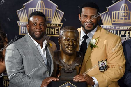 Jerome Bettis, John Bettis III. Former NFL player Jerome Bettis, right, poses with a bust of himself and presenter, his brother, John Bettis III, during an induction ceremony at the Pro Football Hall of Fame, in Canton, Ohio