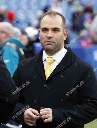 Jacksonville Jaguars general manager David Caldwell walks on the field before an NFL football game against the Buffalo Bills, in Orchard Park, N.Y