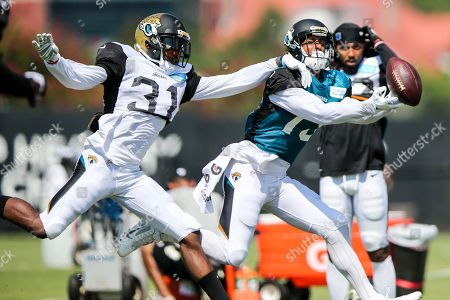 Jeremy Harris, Kerry Taylor. Jacksonville Jaguars corner Jeremy Harris (31) defends receiver Kerry Taylor (13) during a seven-on-seven drill at NFL football practice, first day with pads on in Jacksonville, Fla