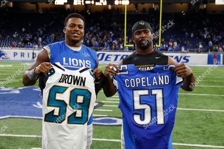 Arthur Brown, Brandon Copeland. Detroit Lions outside linebacker Brandon Copeland, left, and Jacksonville Jaguars linebacker Arthur Brown swap jerseys after their NFL football game, in Detroit