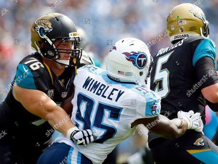 Luke Joeckel, Kamerion Wimbley. Jacksonville Jaguars tackle Luke Joeckel (76) blocks Tennessee Titans outside linebacker Kamerion Wimbley (95) during an NFL football game, in Nashville, Tenn