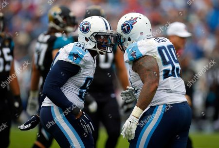 Shaun Phillips, Jurrell Casey. Tennessee Titans outside linebacker Shaun Phillips (58) celebrates with teammate defensive end Jurrell Casey (99) after a play against the Jacksonville Jaguars during an NFL football game, in Nashville, Tenn