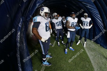 Chris Spencer, Shaun Phillips, Delanie Walker, Michael Oher. Tennessee Titans players Chris Spencer (60), Shaun Phillips (58), Delanie Walker (82) and Michael Oher (72) wait to be introduced before an NFL football game between the Titans and the Jacksonville Jaguars, in Nashville, Tenn