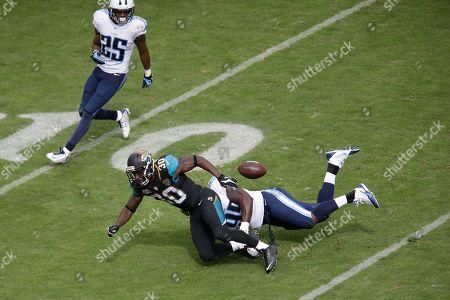 Kamerion Wimbley, Jordan Todman. Tennessee Titans linebacker Kamerion Wimbley (95) breaks up a pass intended for Jacksonville Jaguars running back Jordan Todman (30) in the third quarter of an NFL football game, in Nashville, Tenn