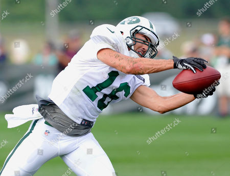 New York Jets wide receiver Scotty McKnight catches a pass at their NFL football training camp, in Cortland, N.Y