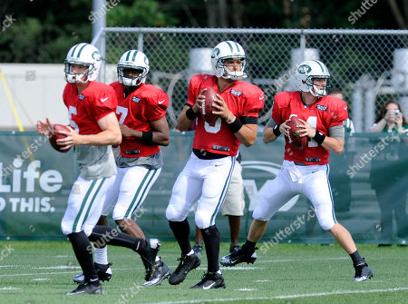 Mark Sanchez, Geno Smith, Greg McElroy, Matt Simms. From left, New York Jets quarterbacks Matt Simms, Geno Smith, Mark Sanchez, and Greg McElroy drop back at their NFL football training camp, in Cortland, N.Y