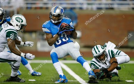 Stock Picture of Pat Edwards, Ellis Lankster, Isaiah Trufant. New York Jets defensive backs Ellis Lankster (21) and Isaiah Trufant (35) close in on Detroit Lions wide receiver Pat Edwards during the first quarter of an NFL football game at Ford Field in Detroit