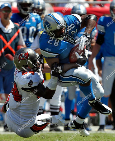 Geno Hayes, Maurice Morris. Tampa Bay Buccaneers linebacker Geno Hayes (54) takes down Detroit Lions running back Maurice Morris (28) on a second-quarter run during an NFL football game, in Tampa, Fla