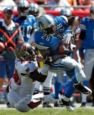 Geno Hayes, Maurice Morris. Tampa Bay Buccaneers linebacker Geno Hayes (54) takes down Detroit Lions running back Maurice Morris (28) on a second quarter run during an NFL football game, in Tampa, Fla