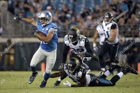 Golden Tate, Davon House, Craig Loston. Detroit Lions wide receiver Golden Tate (15) runs after a catching a pass in front of Jacksonville Jaguars defensive back Davon House (31) and strong safety Craig Loston (20) during the first half of a preseason NFL football game in Jacksonville, Fla