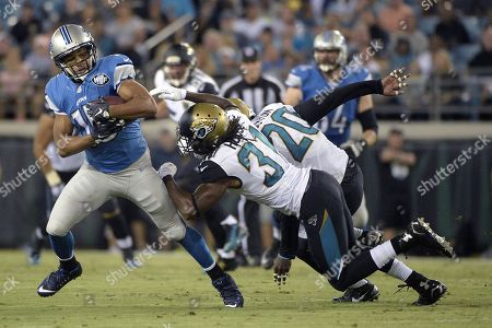 Golden Tate, Davon House, Craig Loston. Detroit Lions wide receiver Golden Tate (15), left, runs after a catching a pass in front of Jacksonville Jaguars defensive back Davon House (31) and strong safety Craig Loston (20) during the first half of a preseason NFL football game in Jacksonville, Fla