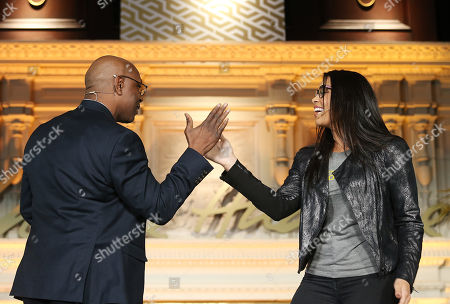 Stock Photo of Jordin Sparks;Phillippi Sparks. Performer Jordin Sparks greets her father, former NFL player, Phillippi Sparks with a special handshake during the NFL Women's Summit, in San Francisco