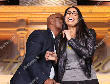 Stock Picture of Jordin Sparks;Phillippi Sparks. Performer Jordin Sparks is kissed on the cheek by her father, former NFL player, Phillippi Sparks during the NFL Women's Summit, in San Francisco