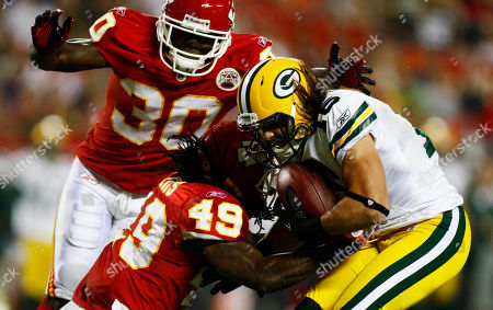 Brett Swain, Javier Arenas, Kendrick Lewis. Green Bay Packers wide receiver Brett Swain (16) is stopped by Kansas City Chiefs defensive back Kendrick Lewis (49) and defensive back Javier Arenas (30) during the first half of a preseason NFL football game in Kansas City, Mo