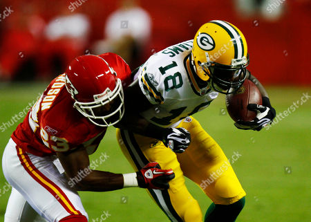 Patrick Williams, Mike Richardson. Green Bay Packers wide receiver Patrick Williams (18) is tackled by Kansas City Chiefs cornerback Mike Richardson (23) during the first half of a preseason NFL football game in Kansas City, Mo