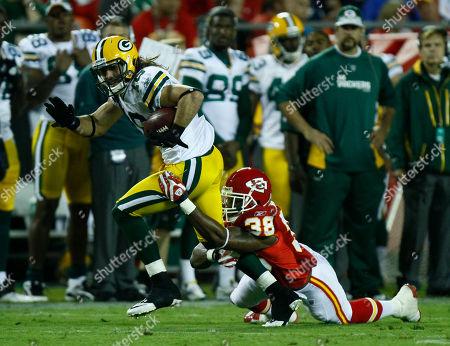 Brett Swain, DaJuan Morgan. Green Bay Packers wide receiver Brett Swain (16) is tackled by Kansas City Chiefs safety DaJuan Morgan (38) during the first half of a preseason NFL football game in Kansas City, Mo