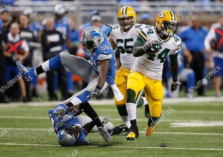 Tahir Whitehead, Devin Taylor, James Stark. Detroit Lions middle linebacker Tahir Whitehead (59) falls over defensive end Devin Taylor (98) while pursuing Green Bay Packers running back James Stark (44) during the second half of an NFL football game, in Detroit