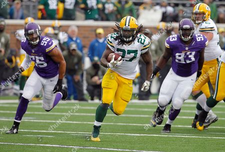 Eddie Lacy, Anthony Barr, Shamar Stephen. Green Bay Packers running back Eddie Lacy (27) runs from Minnesota Vikings outside linebacker Anthony Barr, left, and defensive tackle Shamar Stephen (93) during the second half of an NFL football game, in Minneapolis