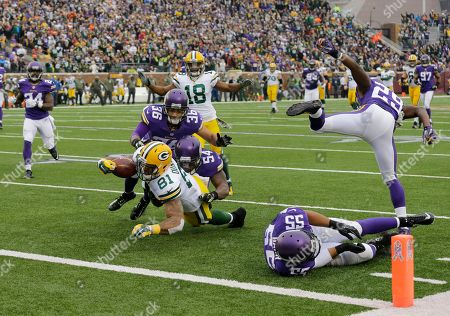 Andrew Quarless, Jasper Brinkley, Robert Blanton. Green Bay Packers tight end Andrew Quarless (81) is tackled by Minnesota Vikings middle linebacker Jasper Brinkley (54) and Vikings strong safety Robert Blanton (36) after a gain during the first half of an NFL football game, in Minneapolis