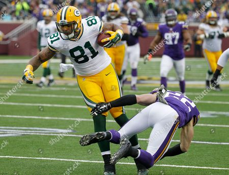 Andrew Quarless, Harrison Smith. Green Bay Packers tight end Andrew Quarless (81) breaks a tackle by Minnesota Vikings free safety Harrison Smith after making a reception during the first half of an NFL football game, in Minneapolis