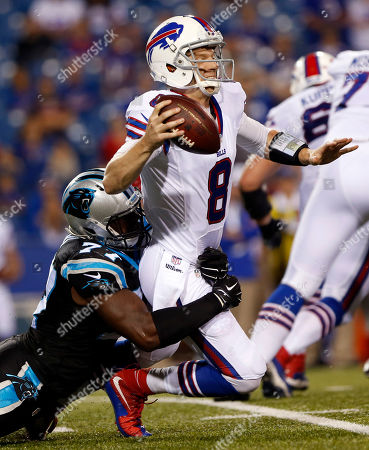Stock Image of Buffalo Bills quarterback Matt Simms (8) is sacked by Carolina Panthers defensive end Rakim Cox (77) during the second half of an NFL preseason football game, in Orchard Park, N.Y. The Panthers won 25-24