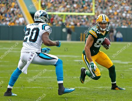 Jordy Nelson, Antoine Cason. Green Bay Packers wide receiver Jordy Nelson makes a catch while being covered by Carolina Panthers cornerback Antoine Cason during an NFL football game, in Green Bay, Wis