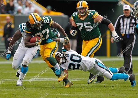 Eddie Lacy, Antoine Cason. Green Bay Packers running back Eddie Lacy breaks the tackle of Carolina Panthers cornerback Antoine Cason during an NFL football game, in Green Bay, Wis