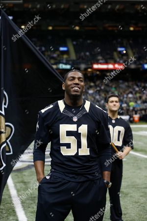 Former New Orleans Saints linebacker Jonathan Vilma acknowledges the crowd as he announces his retirement form football as a New Orleans Saint, before an NFL football game in New Orleans