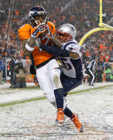 Andre Caldwell, Logan Ryan. Denver Broncos wide receiver Andre Caldwell (12) pulls in a touchdown catch as New England Patriots cornerback Logan Ryan (26) defends during the second half of an NFL football game, in Denver