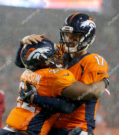 Brock Osweiler, C.J. Anderson. Denver Broncos quarterback Brock Osweiler (17) celebrates his touchdown pass to wide receiver Andre Caldwell, not seen, with Denver Broncos running back C.J. Anderson (22) during the second half of an NFL football game, in Denver