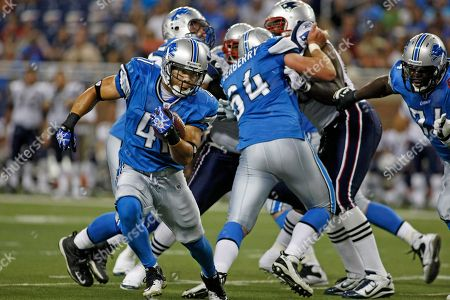Detroit Lions' running back Ian Johnson (41) rushes in the third quarter of a preseason NFL football game with the New England Patriots, in Detroit, Mich