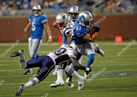 Darius Butler, Ian Johnson. New England Patriots cornerback Darius Butler (28) tries to tackle Detroit Lions running back Ian Johnson (41), in the third fourth quarter of a preseason NFL football game, in Detroit, Mich
