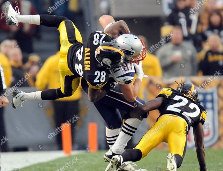 Cortez Allen, William Gay, Dan Gronkowski. Pittsburgh Steelers defensive back Cortez Allen (28) and William Gay (22) tackle New England Patriots tight end Dan Gronkowski (87) during the third quarter of an NFL football game, in Pittsburgh. Pittsburgh won 25-17