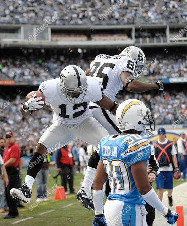 Oakland Raiders wide receiver Jacoby Ford against the San Diego Chargers during their NFL football game, in San Diego, as San Diego Chargers cornerback Donald Strickland looks on at right