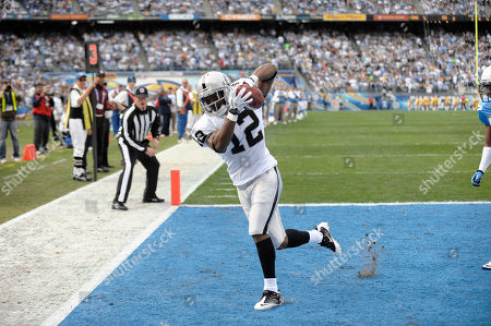 Jacoby Ford, Donald Strickland. Oakland Raiders wide receiver Jacoby Ford makes a catch for a touchdown in the first half against the San Diego Chargers during their NFL football game, in San Diego, as San Diego Chargers cornerback Donald Strickland looks on at right